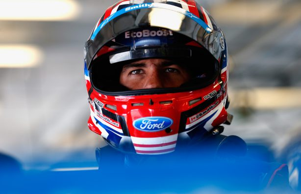 SPARTA, KENTUCKY - JULY 07:  Darrell Wallace Jr., driver of the #43 Smithfield Ford, stands in the garage during practice for the Monster Energy NASCAR Cup Series Quaker State 400 presented by Advance Auto Parts at Kentucky Speedway on July 7, 2017 in Sparta, Kentucky.  (Photo by Brian Lawdermilk/Getty Images)